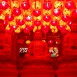 Chinese temple with three buddhas. paper lanterns are coloring e — Stock Photo