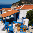 Greek tavern with blue chairs, panoramseview — Stock Photo #39145213