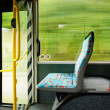 Empty seat in a trolley bus. blurred background — Stock Photo #39145855