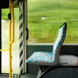 Empty seat in a trolley bus. blurred background — Stock Photo
