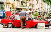 Flea market on red car in the street — Stock Photo
