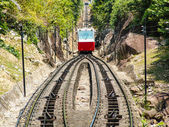 Red rack railway climing up the hill — Stock Photo