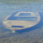 Sunken fishing boat — Stock Photo