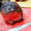 Roast beef with knife. landscape — Stock Photo #46875609