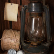 Old kerosene stove, clock and a roll of twine — Stock Photo #44154703