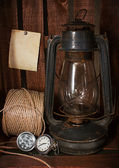 Old kerosene stove, clock and a roll of twine — Стоковое фото