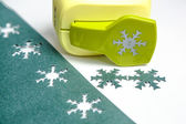 Holepunch and paper snowflakes — Stock Photo