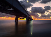 Sunset at bridge long exposure — Stock Photo