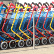 Line of colorful shopping carts in daylight — Zdjęcie stockowe #40415687
