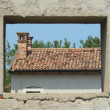 Window framing a abandon farm house — Stock Photo