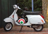 White motorcycle with helmet in italian colors — Stok fotoğraf