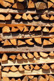 Close up on vertical placed pile of fire wood in vertical — Stock Photo