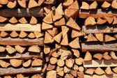 Close up on orderly placed pile of fire wood — Stock Photo