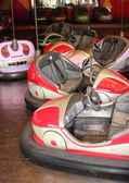 Empty red bumper cars at fair gound — Zdjęcie stockowe