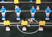 Football table game with blue and yellow players — Foto de Stock