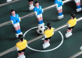 Football table game with blue and yellow players — Stockfoto