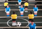 Football table game with blue and yellow players — Stock Photo
