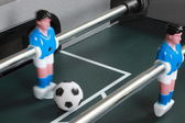 Football table game with blue goal keeper — Stok fotoğraf