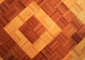 Teakwood floor of quadratic sticks forming two quadrants — Stock Photo