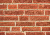 Red brick wall with grey mortar — Stock Photo