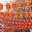 Chinese paper lamps hanging over city street — Stock Photo #40869923