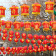 Chinese paper lamps hanging over city street — Stock Photo