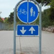 Stock Photo: Sign to separate promenade and biking arewith two way arrow