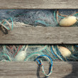 Blue industry fishing nets in old wooden storage box — Stock Photo #41354493