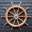 Old trawler steering wheel made of hardwood — Stock Photo