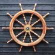 Stock Photo: Old trawler steering wheel made of hardwood