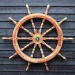 Old trawler steering wheel made of hardwood — Stock Photo
