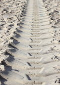 Heavy tractor track in dry beach sand in summer — Stock Photo
