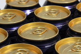 Metal beer cans with gold top plating — Stock Photo