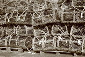 Pile of worn fishing traps for eels — Stock Photo