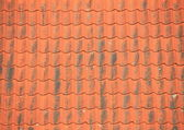Old red roof tiles with black patina — Stock Photo