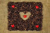 Little hearts on coffee beans — Stock Photo