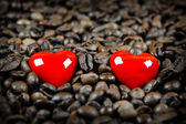 Two red hearts in coffee beans — Stock Photo