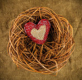 One handmade heart in the nest — Stock Photo