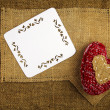 Stock Photo: Knitting heart on sackcloth