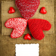 Stock Photo: Knitting hearts on sackcloth