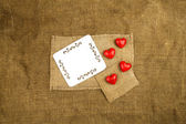 Hearts on the sackcloth — Stock Photo