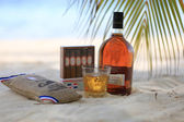 Rum, coffee and cigar at the beach — Stock Photo