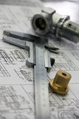 Measuring tool and workpiece rests with the drawing — Stock Photo