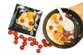 Eggs with cherry tomatoes in a pan — Stock Photo