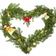 Christmas frame in the shape of a heart with yellow decorations — Stock Photo #51732437