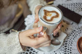 Cup of coffee with heart shape — Stock Photo