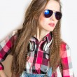 Happy young woman in plaid shirt — Stock Photo
