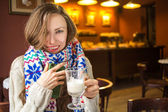 Woman drinking coffe in a cafe — Stock Photo