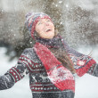 Happy young woman having fun on a snowy winter day outdoors — Stock Photo