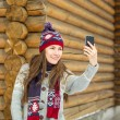 Young woman taking photo in a beautiful winter day — Stock Photo